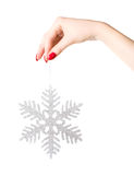 Woman hand holding big holiday snowflake Stock Image