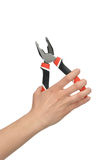 Woman Hand holding big pliers with black and red handles Royalty Free Stock Image