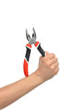 Woman Hand holding big pliers with black and red handles Stock Images