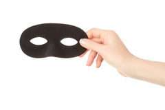 Woman hand holding black mask Stock Photo