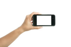 Woman hand holding black smart phone with blank screen Royalty Free Stock Photos