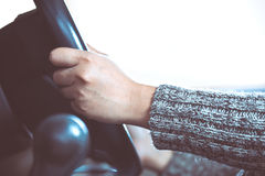 Woman hand holding on black steering wheel while driving a car Royalty Free Stock Photography
