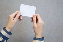 woman hand holding blank card in gray background. royalty free stock photo