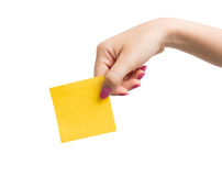 Woman hand holding blank yellow notepaper Stock Photos
