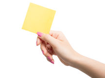 Woman hand holding blank yellow notepaper Royalty Free Stock Image