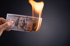 Free Woman Hand Holding Burning Burning Dollar Cash Money Over Black Background - Business Finances, Savings And Bankruptcy Concept Royalty Free Stock Photo - 146272495