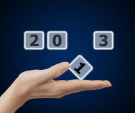 Woman hand holding button 2013 keyword Royalty Free Stock Photography