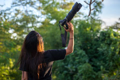 Woman hand holding camera. In the nature Royalty Free Stock Photography