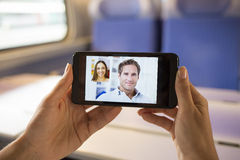 Woman hand holding a cell phone during a skype video Royalty Free Stock Image