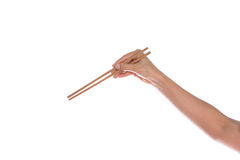 Woman hand holding chopsticks, isolated on white Royalty Free Stock Photography