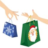 Woman hand holding christmas shopping bag. Two graceful woman hands holding Christmas shopping bags. All elements are grouped together and can easily be edited stock illustration