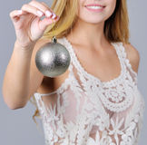 Woman hand holding Christmas tree ball Stock Images