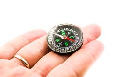 Woman hand holding chrome compass over white background Royalty Free Stock Photos