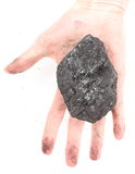 Woman hand holding coal lump on white background Royalty Free Stock Photography