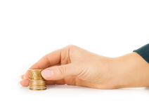 Woman hand holding coins isolated Stock Photography