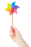 Woman hand holding colorful pinwheel Royalty Free Stock Photo
