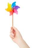 Woman hand holding colorful pinwheel royalty free stock photo