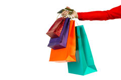 Woman hand holding colourful shopping paper bags, banking credit Royalty Free Stock Images