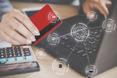 Woman hand holding credit card e- commerce concept background. Woman hand holding credit card and digital technology computer iot icons , e- commerce concept stock image