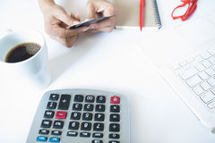 Woman hand holding credit card and using calculator and laptop Royalty Free Stock Images