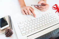 Woman hand holding credit card and using laptop, Online shopping Stock Image