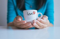 Woman hand holding a cup of coffee stock images