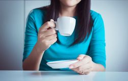 Woman hand holding a cup of coffee stock photo