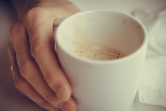 Woman hand holding cup of coffee drinking Royalty Free Stock Photography
