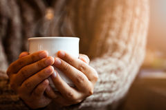 Woman hand holding the cup of coffee or tea in the cafe royalty free stock images