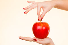 Woman hand holding delicious red apple Royalty Free Stock Photos