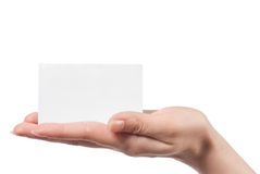 Woman hand holding empty visiting card. Isolated on white Royalty Free Stock Photography