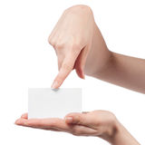 Woman hand holding empty visiting card. And pointing on it isolated on white Stock Photo