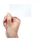 Woman hand holding empty visiting card. Isolated on white Stock Photos