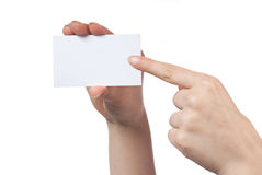 Woman hand holding empty visiting card. And pointing on it isolated on white Royalty Free Stock Photography