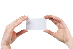 Woman hand holding empty visiting card isolated. On white Royalty Free Stock Image