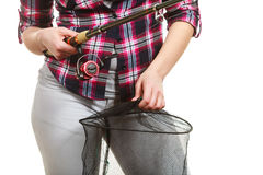 Woman hand holding fishing rod and keepnet Royalty Free Stock Image