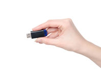Woman hand holding a flash drive isolated on white background Stock Photos