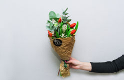 Woman hand holding flowers Royalty Free Stock Image