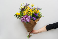 Woman hand holding flowers Royalty Free Stock Images