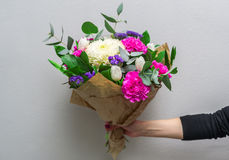 Woman hand holding flowers Royalty Free Stock Photo