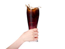 Woman hand holding fresh Cola with ice cubes. On a white royalty free stock photo