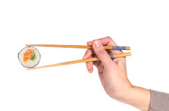 Woman hand holding fresh maki sushi roll Stock Images