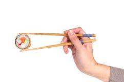 Woman hand holding fresh maki sushi roll Stock Photo