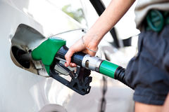 Woman hand holding fuel nozzle Stock Photography