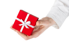 Woman hand holding a gift. clipping path. Woman hand holding a gift.  isolated on white Stock Image