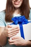 Woman hand holding gift or present box Royalty Free Stock Photos
