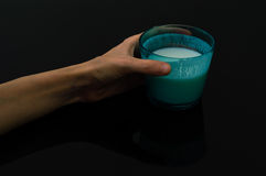Woman hand holding a glass of kefir Stock Photos