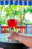 Woman hand holding a glass of red wine Royalty Free Stock Photos