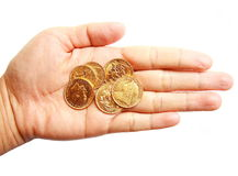 Woman hand holding gold coins on isolated white Royalty Free Stock Image
