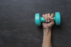 Woman hand holding green dumbbell Royalty Free Stock Photo